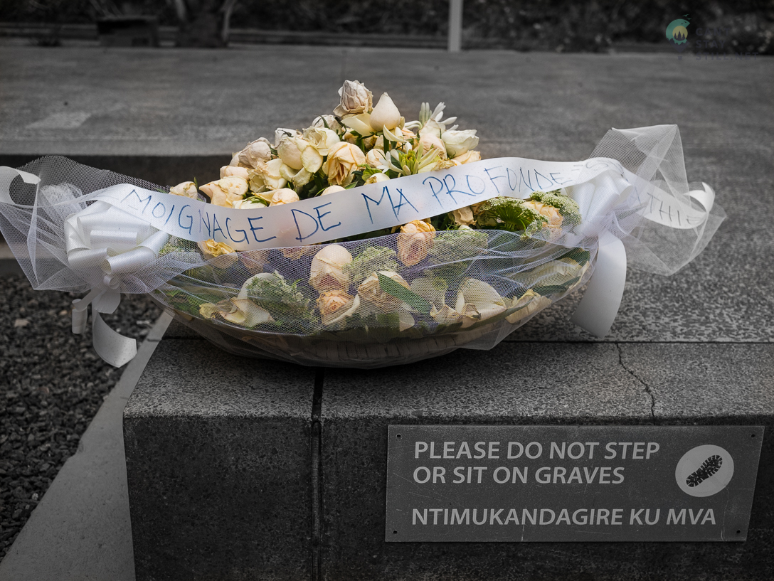 flowers deposited at the Kigali Genocide Memorial, a place where locals come to pay their respects to the lost friends and family.