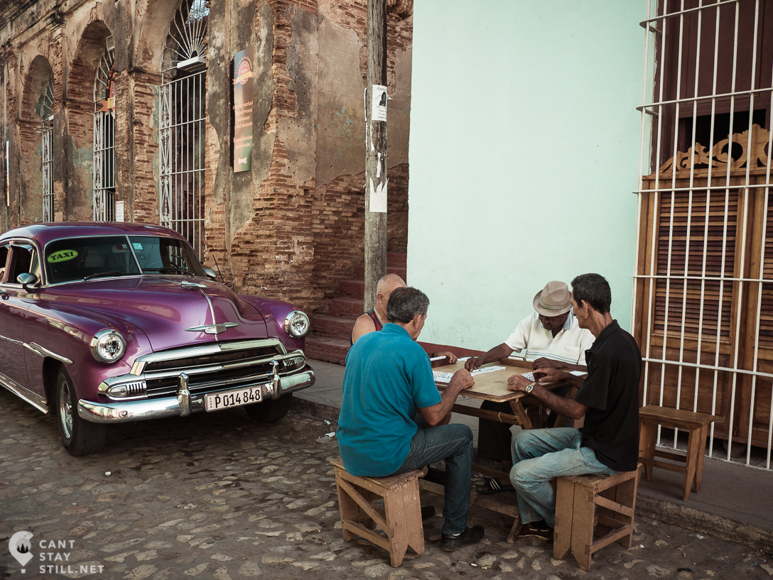 Cubans playing domino on the streets of Trinidad, Cuba