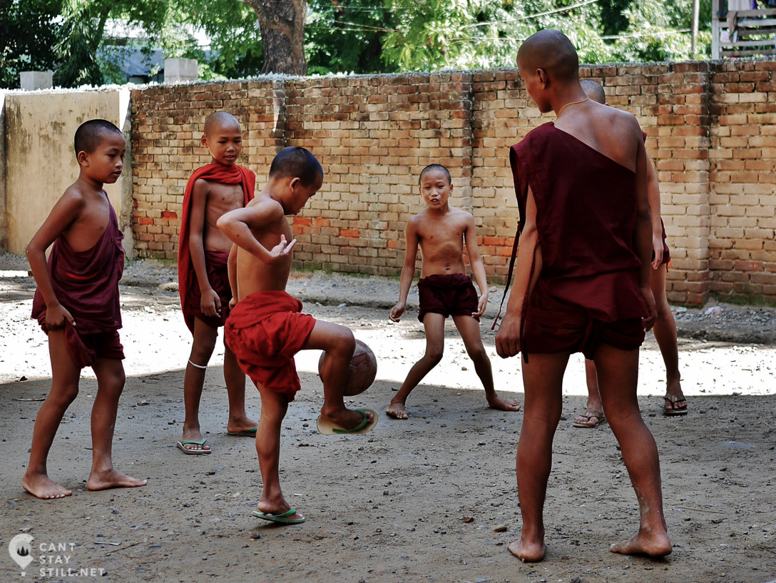 novice monks playing ball at a monastic school in Mandalay, Myanmar
