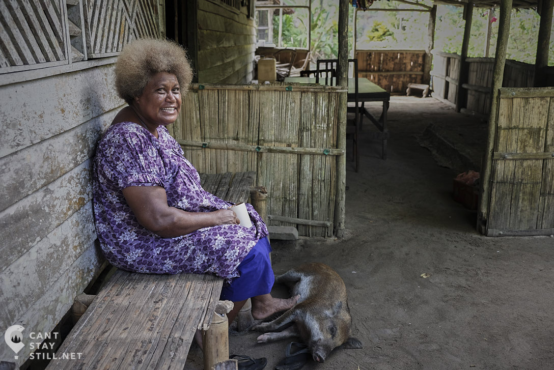Watten on the porch with the pig in New Ireland, Papua New Guinea