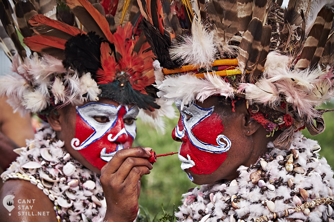 women applying facepaint at the Mt. Hagen Show in Papua New Guinea PNG