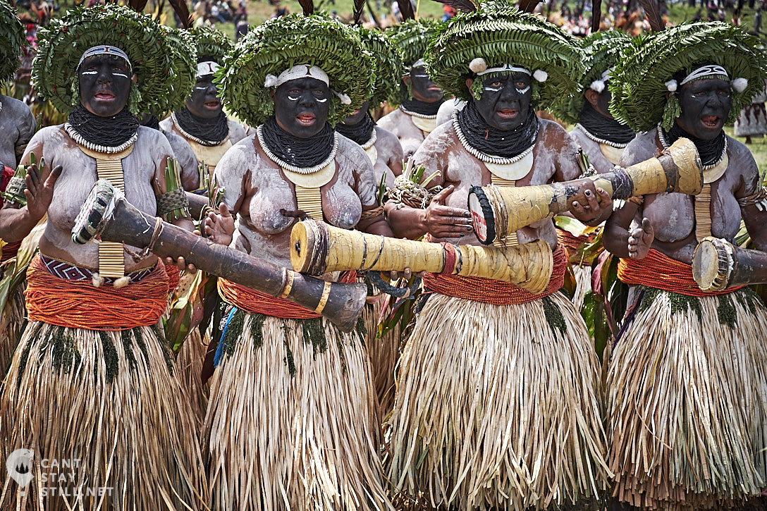 women singing and drumming at the Mt. Hagen Show in Papua New Guinea PNG