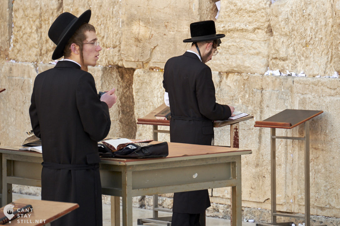 two ultra-orthodox jewish young men praying at the Wailing Wall in Jerusalem